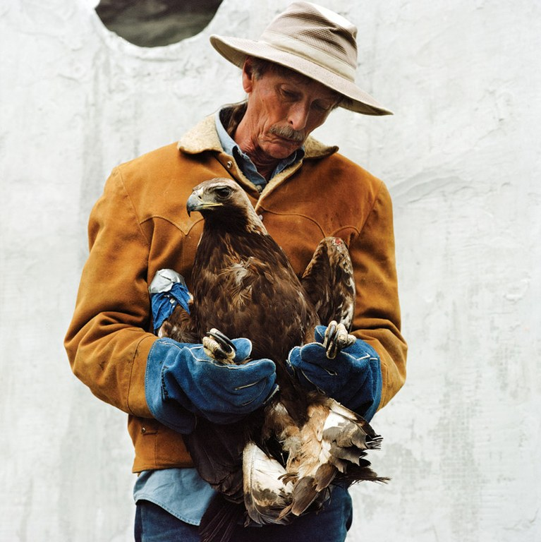 Bill Hodge holds a golden eagle.
