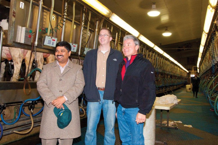 Malhotra with the new Empire Dairy lighting project in Wiggins, with Riley McLaughlin of Sustainable Building Experts and Bill Annan of the Morgan County REA.