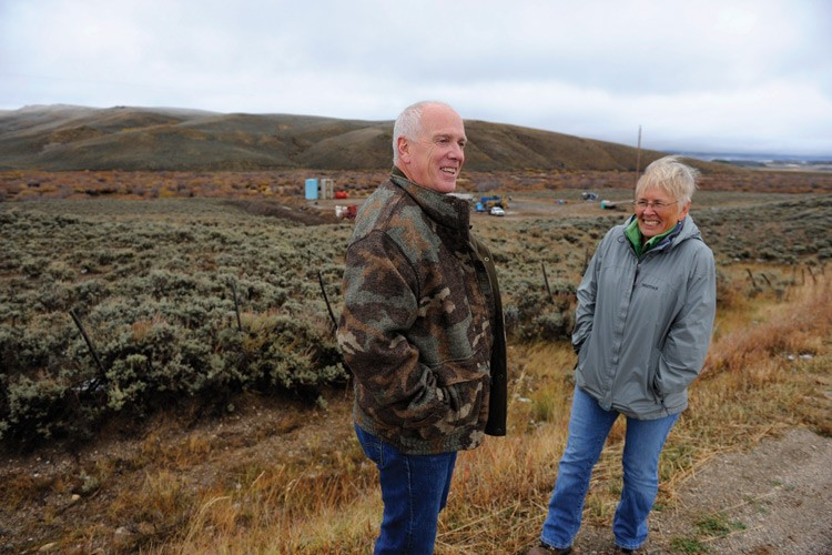 Bob Meulengracht of Trout Unlimited and Sportsmen for Responsible Energy Development and environmental activist Barbara Vasquez stand in front of an oil well drilled near the Michigan River in North Park, Colorado