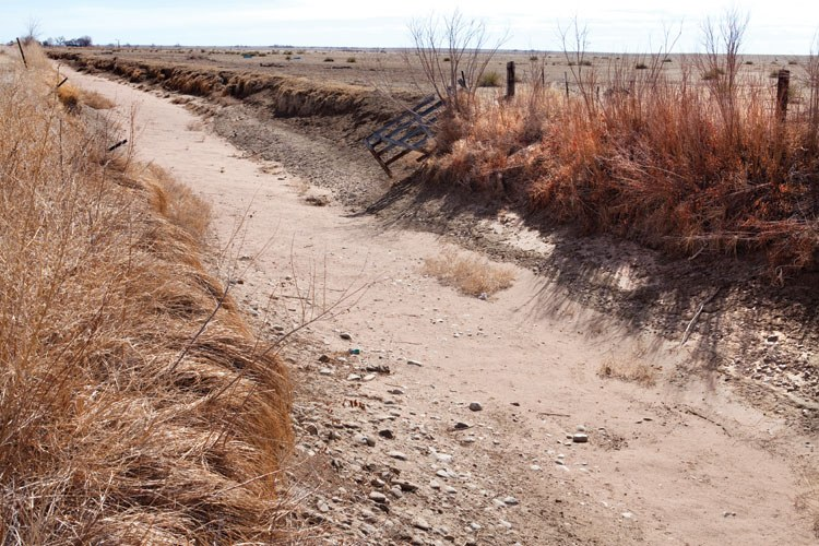 A dry ditch in Crowley County, where only 4 percent of the historic cropland is still farmed.