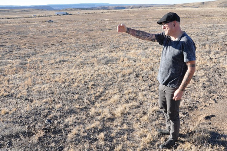 Archaeologist Jack Pfersth points out remnants of portions of the Salt Lake Wagon Road running parallel to US 50, north of Delta, Colorado.
