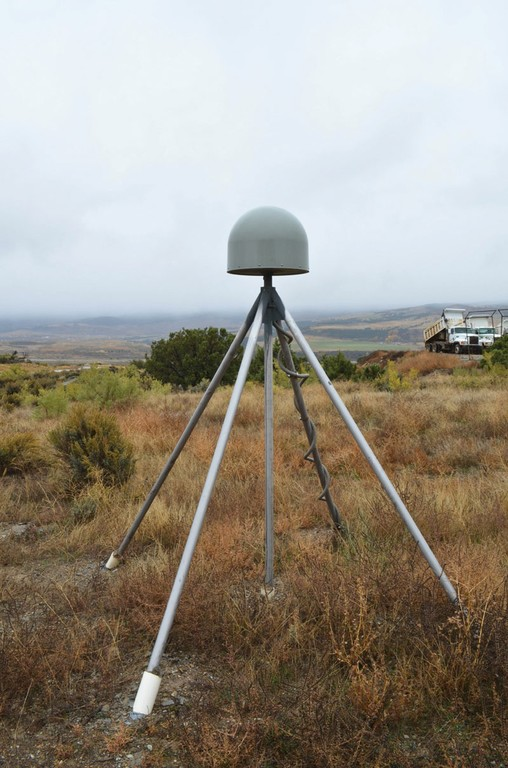 Station P031 measures crustal motion from its spot on a sagebrush flat in the middle of the West Garfield County landfill near Rifle, Colorado.