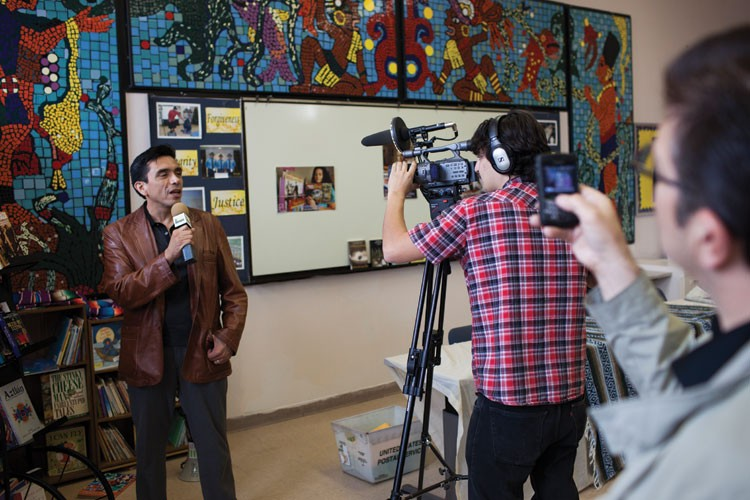Tony Diaz, activist and organizer of the movement, talks to the media.