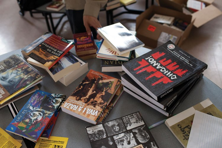Books are sorted at the John Valenzuela Community Center during the librotraficante event in Tucson in March.  Some of the books were removed from Tucson classrooms by the state government.