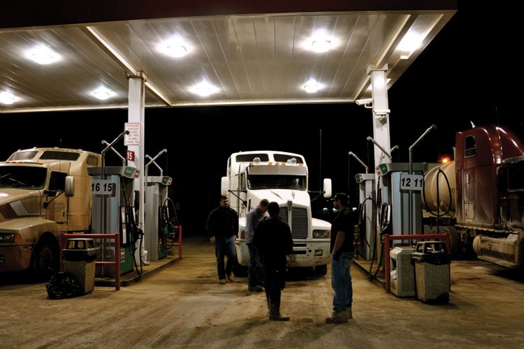 Truck drivers fill up at the Cenex station in New Town. Most oil workers have come from off the reservation, some from as far away as South Africa and Brazil.