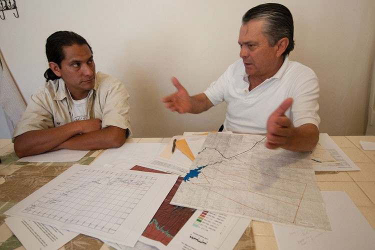 Robles, right, and Sergio Avila of Sky Island Alliance, use maps to plan restoration efforts.