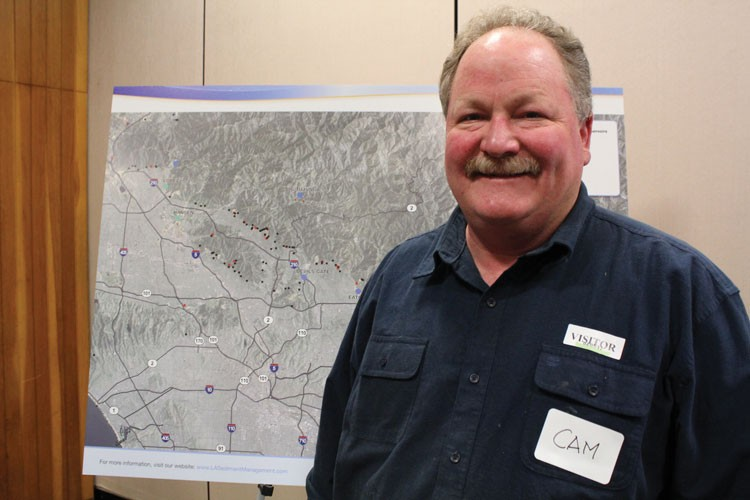 Camron Stone last month in front of a watershed map at the L.A. County Department of Public Works, where the Flood Control District had just released its strategic plan showing sediment outpacing dump capacity over the next 20 years.