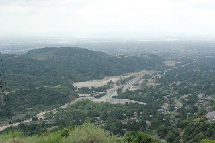 The Santa Anita Creek Wash, remade by the L.A. County Flood Control District last winter. To the right (west) is Camron Stone's neighborhood, with its 1950s houses which were marketed highlighting their proximity to the noble oaks of Arcadia. In the background, Arcadia and the L.A. Basin.