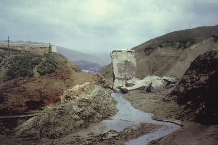 St. Francis Dam (colorized) after its catastrophic failure in 1928 resulted in flooding that killed more than 450 people.