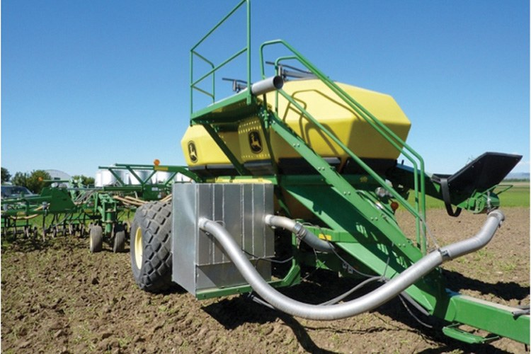 The Bio-Agtive system runs diesel exhaust through a cooler and conditioner to the tractor's air seeder.