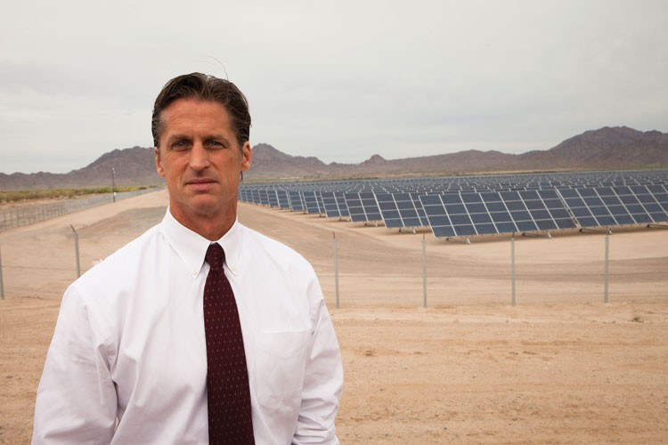 "Frederick ""Rick"" Buss, town manager of Gila Bend at the Cotton Center solar field on the edge of town, just one of  the projects he's been instrumental in bringing to the area."