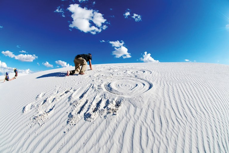 Sunny Tang drawing on the dunes at White Sands National Monument, New Mexico, 2010.