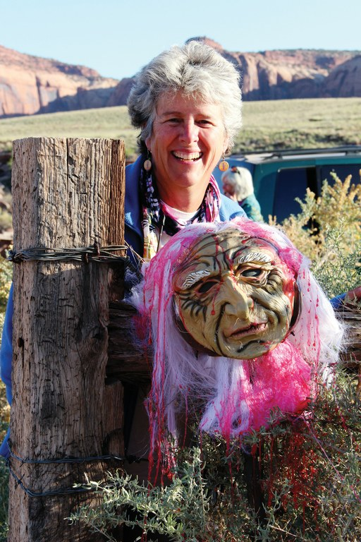 Rose Chilcoat, associate director of Great Old Broads for Wilderness, poses in southeast Utah with the old hag mask meant to intimidate her.