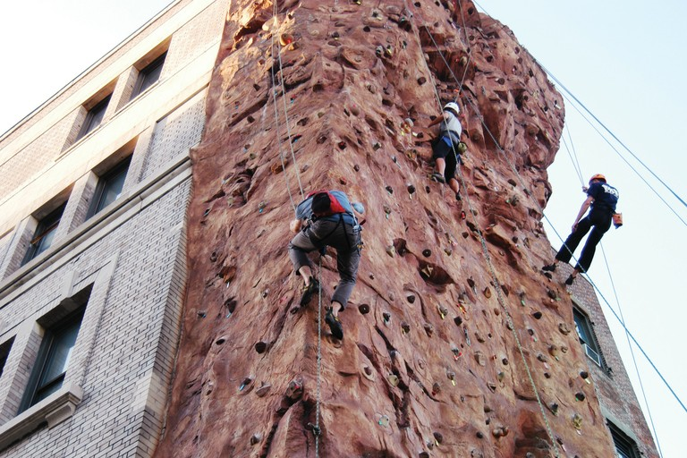 NYC Outward Bound students on the climbing wall in Queens, New York.