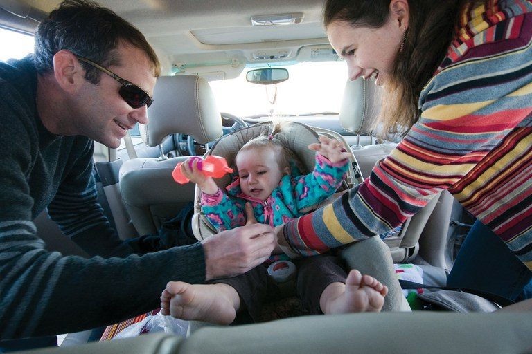 Cory and Amy Hatch strap their 15-month-old daughter, Grace, into her car seat to take her to day care and then commute over Teton Pass to their jobs in Jackson. The Hatches purchased a three-bed