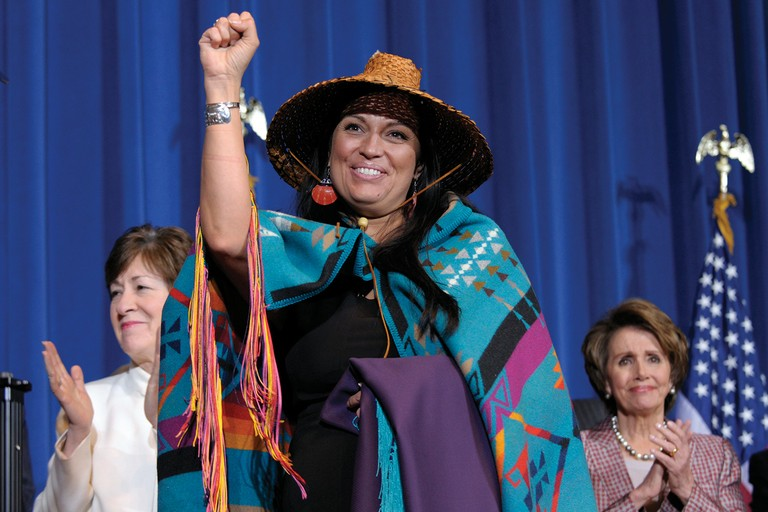 Deborah Parker, vice chairwoman of the Tulalip Tribes of Washington state, center, gestures during the March ceremony at which President Barack Obama signed the Violence Against Women Act into law.