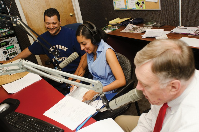 Axel Contreras, left,  works the controls while Lulu Hartman and Ted Hess provide bilingual immigration advice during the weekly Punto Legal radio show.