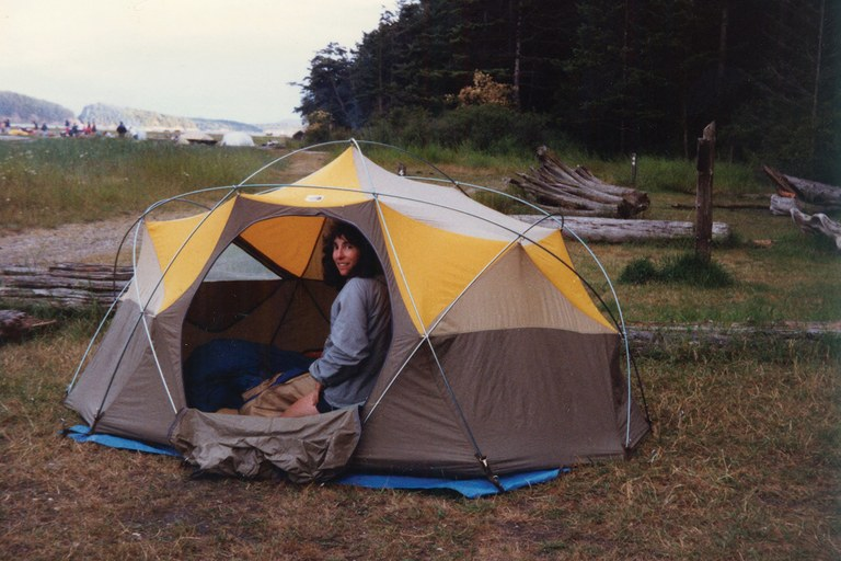 The author's mother in the Oval Intention tent during a 1983 camping trip in the San Juan islands.