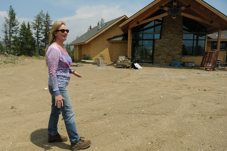 Elizabeth Wallace at the construction site of her new home outside of Boulder. Her previous home burned in the 2010 Fourmile Fire.