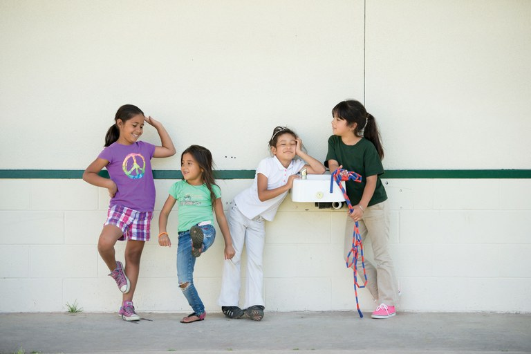 Lizbeth Segura, Evelyn Montes, Karina Martinez and Ivon Peña, from left, play next to a disconnected water fountain at Stone Corral School in Seville, California. The school budgets about $500 a month for bottled water.