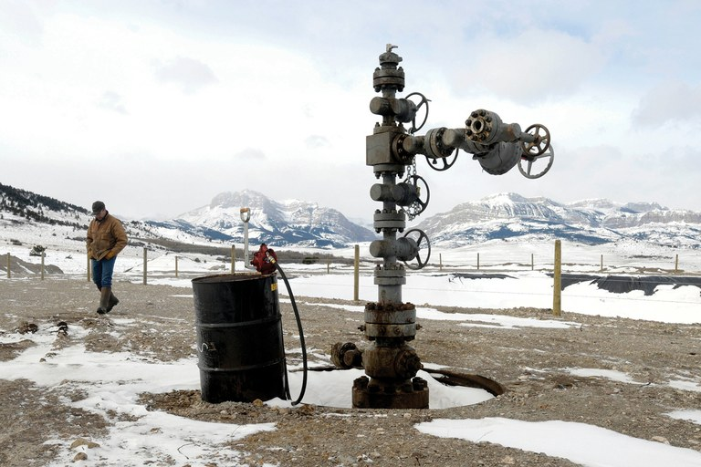 Mike Briggs, ranch manager at the Theodore Roosevelt Memorial Ranch along the Rocky Mountain Front, walks by the capped wellhead left after an oil exploration company drilled on the ranch last fall looking for an economically feasible amount of oil.