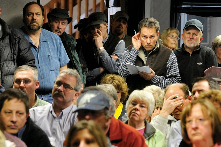A standing-room-only crowd listens to state and county officials during a meeting in Choteau regarding the effects of energy development in the area.
