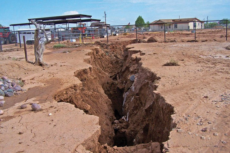 A fissure opened near a home in Chandler Heights, Arizona, after heavy summer rains in 2007.
