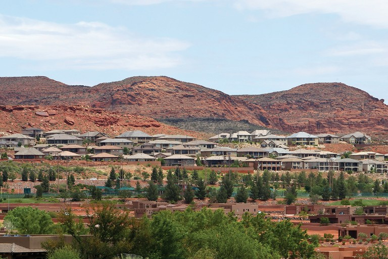 Houses creep into the foothills around St. George, Utah. Washington County commissioners used wilderness lands as a bargaining chip to win more ground for subdivisions and shopping malls.