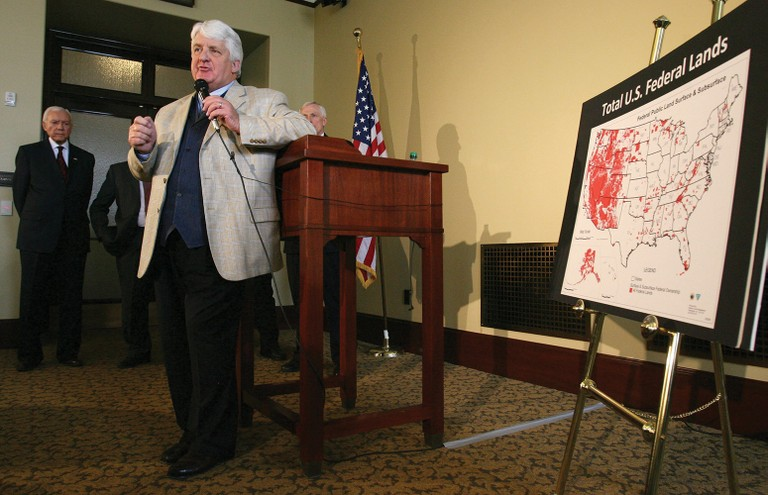 Utah Rep. Rob Bishop displays a map showing federal land ownership, during a 2012 news conference at the Utah State Capitol to laud the Legislature for its effort to take control of millions of acres of federal lands. Sen. Orrin Hatch looks on.