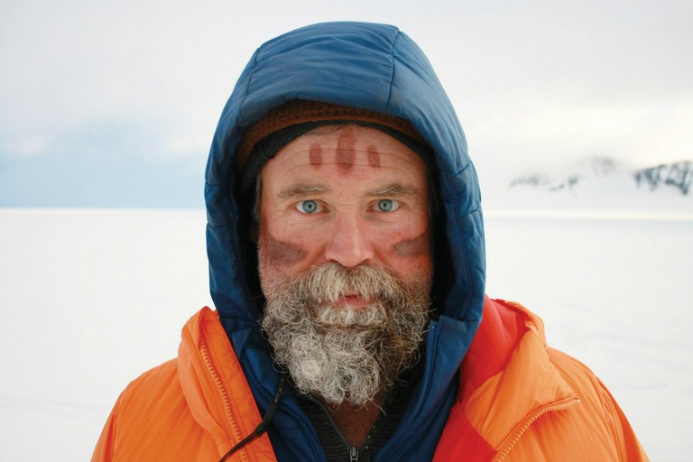 Author and adventurer Craig Childs, with Utah desert sand smeared on his cheeks, on Alaska's Harding Icefield.