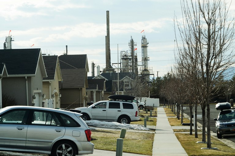 The Silver Eagle refinery looms over a subdivision in Woods Cross, where residential and industrial real estate are never far apart.
