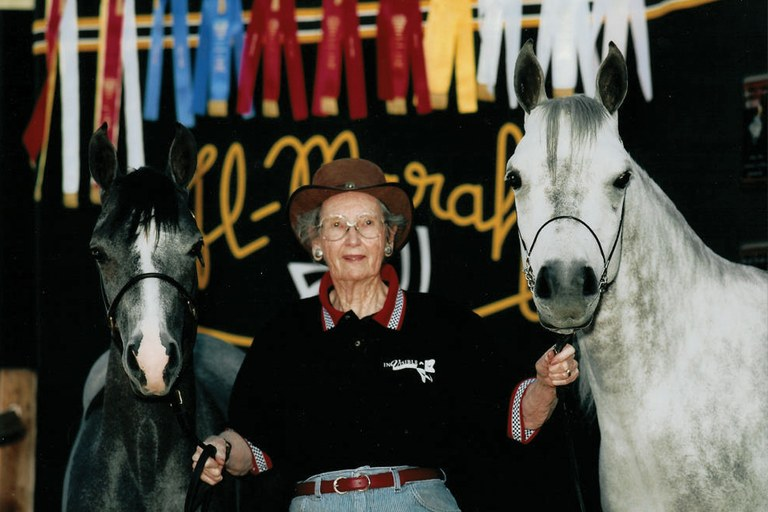 Bazy Tankersley with two of her prized Arabian horses in 1993.