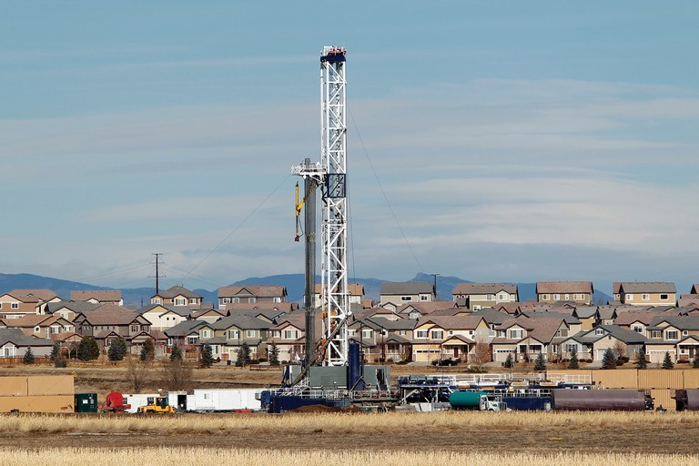 An oil well being drilled on a property across from a subdivision near Frederick, Colorado.