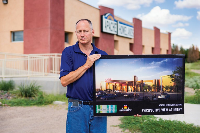 Fort Sill Apache Tribal Chairman Jeff Haozous displays an artist's rendering of the casino he's fighting to get approved for the Apache Homelands Indian Reservation in southwestern New Mexico.