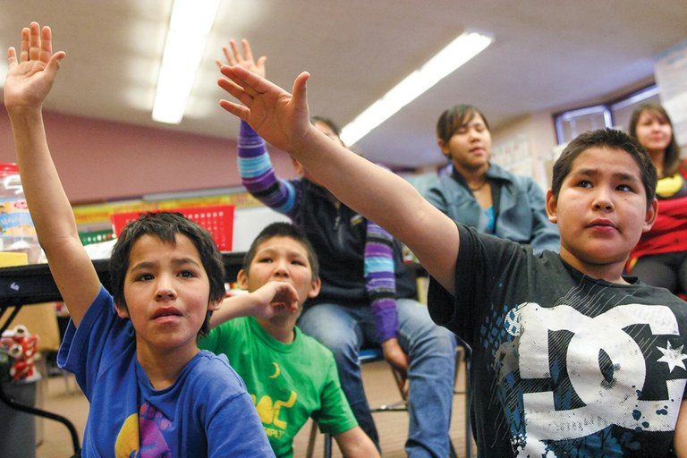 Students of the Gusty Michael School in Stony River, Alaska, shown during a discussion about a trip to Washington, D.C., have had to donate money they raised for field trips to cover the school's operating costs.