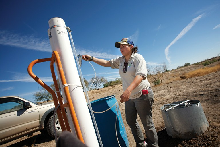Alejandra Fonseca of Pronatura experiments to see how much water a square meter of riverbed can absorb, which will help determine how much water is needed to sustain small pockets of wetlands in the Colorado River Delta.