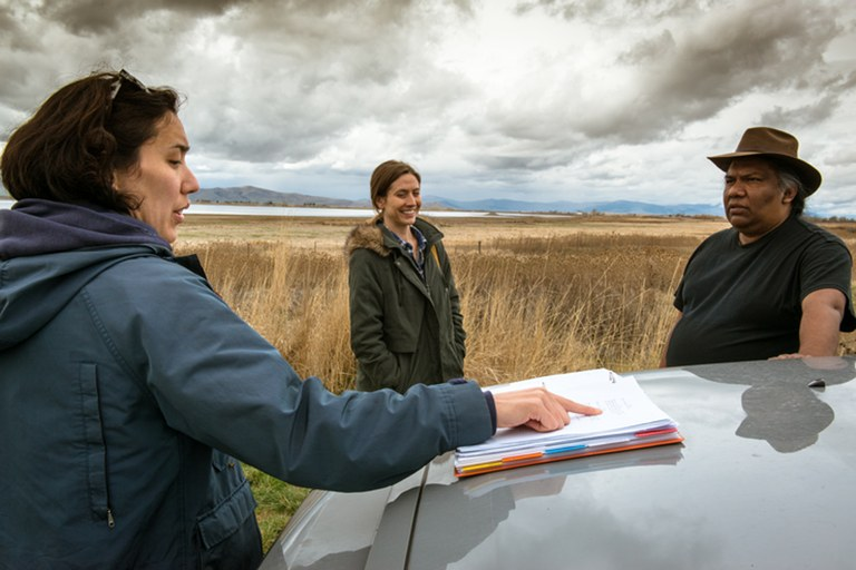 Vera Brunner-Sung, left, talks with actors Kathleen Wise and Sam Sandoval while filming for Bella Vista at the Ninepipe Wildlife Refuge in Montana. Brunner-Sung wrote and directed the film, based on her own experiences after moving to the state.