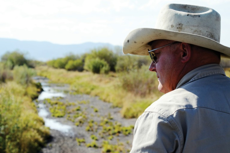 Ed Nielsen has senior water rights on his ranch, where he flood irrigates with creek water. But pumpers have diminished the water table, leaving some of his fields dry.