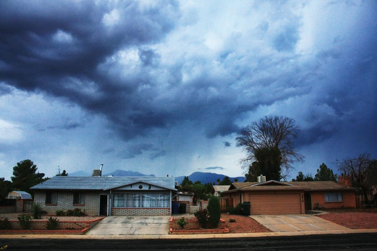 A summer storm passes over homes in Sierra Vista.