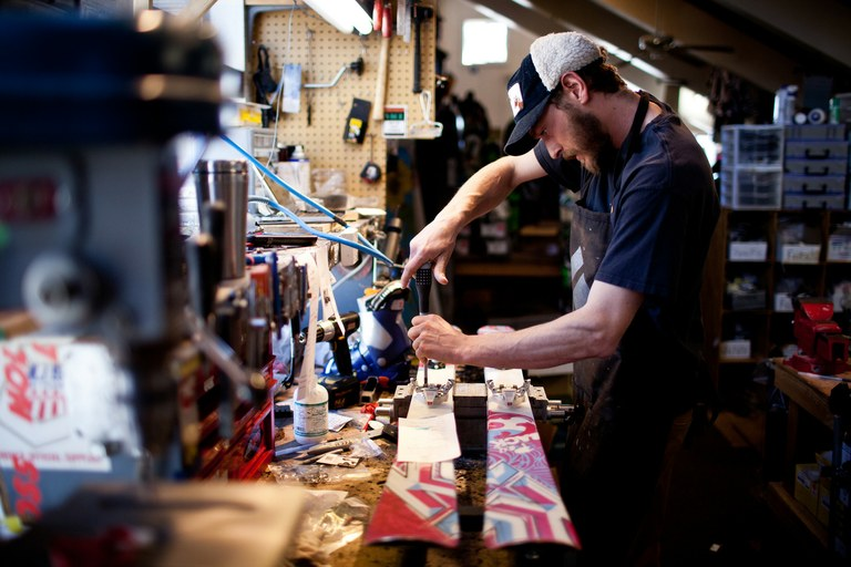 Ski tech Ed Sisino works on a pair of skis at Mammoth Mountaineering Supply in Mammoth Lakes, California. Sisino says the 2011-12 ski season was a tough one for local businesses.