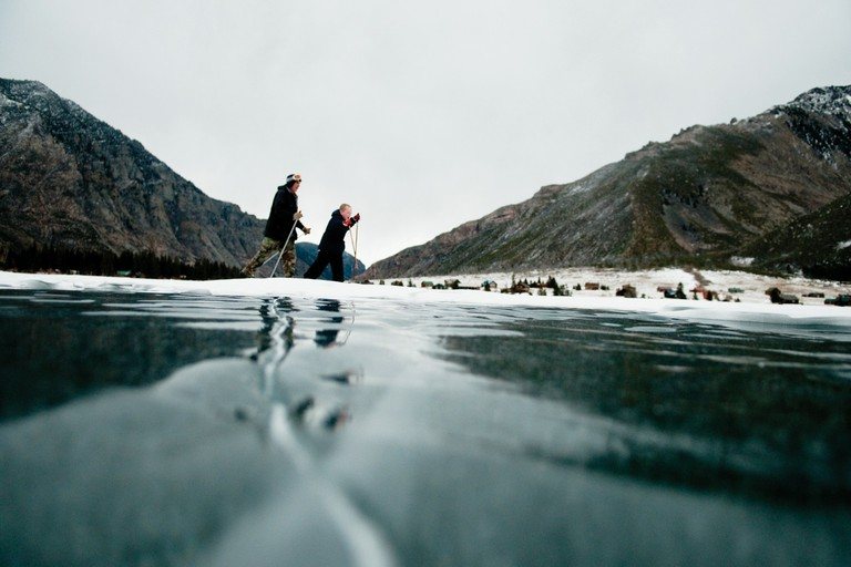 Karl Morledge skis with his grandson across the icy lake near Alpine, actually a small group of private cabins.