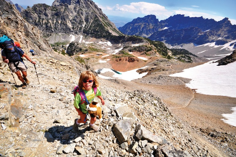 The Lanza family, led by photographer and writer Michael Lanza and his wife, Penny Beach, make frequent family backcountry excursions. Alex Lanza, then 6, hikes across Paintbrush Divide in Grand Teton National Park.