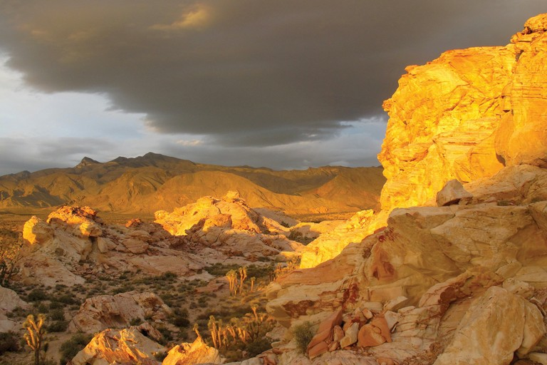 "The sun sets under stormy skies in Gold Butte, Nevada. ""Three hours from Vegas and I feel like I'm on the moon."""