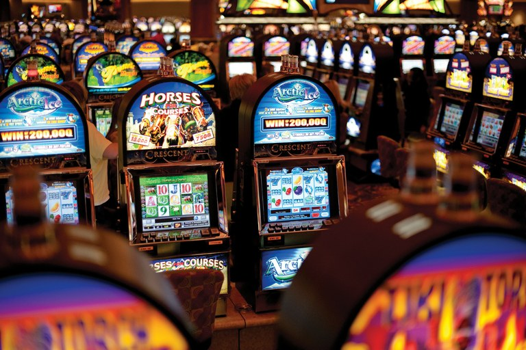 Slot machines fill Snoqualmie Casino in Washington, to which tribal leaders are considering adding a hotel, conference center, and theater.