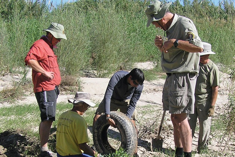 Volunteers clean up tires and every imaginable kind of trash from the banks of the Rio Grande.