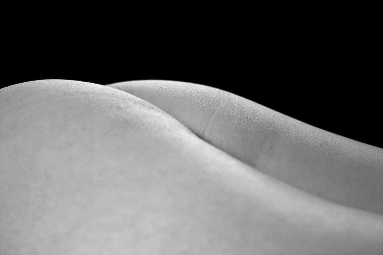 Photographer Jonathan Coe uses angles and lighting techniques to create landscape-like abstract images from the human body.