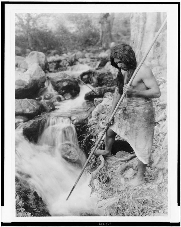 An Edward Curtis photograph, ca. 1923: Watching for Salmon – Hupa.