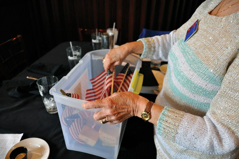 A Reagan Republicans member cleans up after a political luncheon in Coeur d'Alene, Idaho.