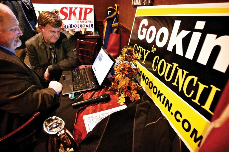 Dan Gookin, candidate for the Coeur d'Alene city council and Jeff Ward (with beard), president of the Kootenai County Reagan Republicans, review election results in 2011. Gookin, after publicizing his opponent's support of President Obama, won in a landsl