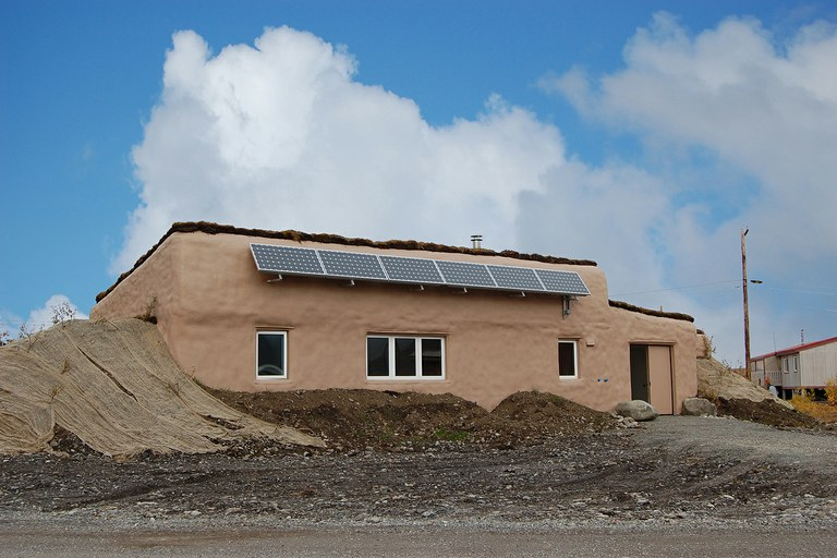 An earth-bermed demonstration home built by the Tagiugmiullu Nunamiullu Housing Authority in North Slope Borough, Alaska.